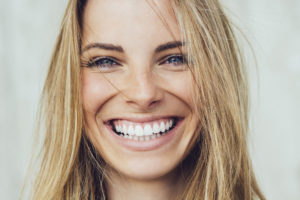 white woman smiling with teeth